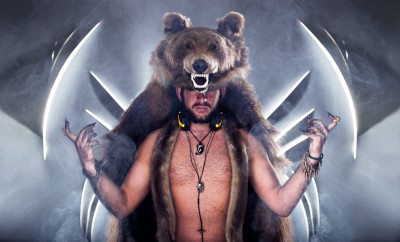 Scary man in a bear coat with scar