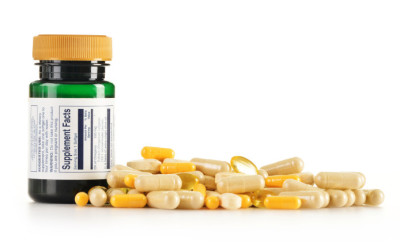 Composition with dietary supplement capsules. Drug pills